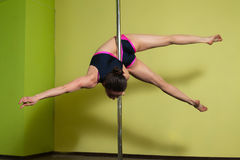 Pole dancer in the pole dance studio Stock Photos