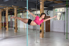 Pole dancer practicing in fitness club Royalty Free Stock Photography