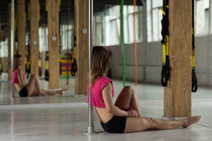 Pole dancer resting after training Stock Image