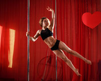 Pole dancer stands on the pylon. Jump Royalty Free Stock Photography