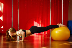 Pole dancer stretches before classes Stock Images