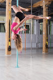 Pole dancer during training Stock Photo