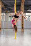 Pole dancer upside down Royalty Free Stock Photos