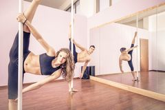Pole dancers Royalty Free Stock Photography