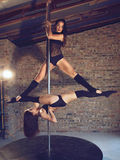 Pole dancers Stock Photos