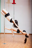 Pole dancers working out together Royalty Free Stock Image