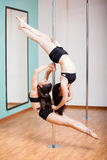 Pole dancing beautifully together Royalty Free Stock Image