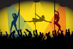 Pole Dancing Girls And Crowd Royalty Free Stock Image