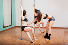 Pole dancing instructor working Stock Image