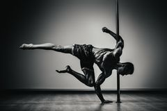 Pole dancing man Stock Photo