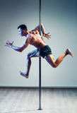 Pole dancing man Royalty Free Stock Photography
