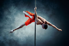 Pole dancing man Stock Photography