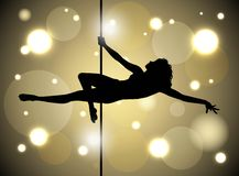 Pole dancing. Silhouette of a sexy female pole dancing Royalty Free Stock Images