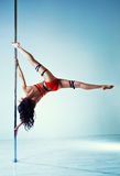 Pole dancing woman Royalty Free Stock Photos