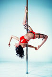 Pole dancing woman Royalty Free Stock Photography