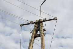 Pole with electric cables. Five lines stock photography