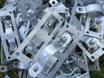 Pole fasteners. A pile of pole fasteners background royalty free stock photo