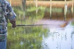 Pole-Fischen Stockbild