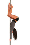Pole fitness. Young woman exercising pole dance fitness Royalty Free Stock Images