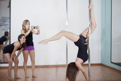 Pole fitness demonstration Stock Images