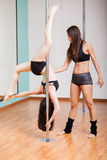 Pole fitness instructor in class Royalty Free Stock Images