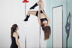 Pole fitness instructor supervising Royalty Free Stock Photography