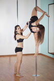 Pole fitness student and instructor Stock Photos