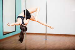 Pole fitness student working out Stock Image