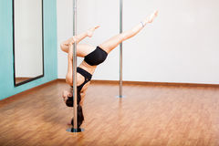 Pole fitness student working out Royalty Free Stock Photography