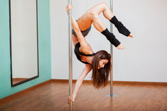 Pole fitness student working out Royalty Free Stock Image