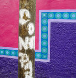Pole in front of a painted wall Stock Images