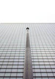 Pole in front of skyscraper windows Stock Photography
