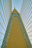 Pole of hang sling of suspension bridge. Day time view Royalty Free Stock Photo