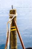 Pole with hawser Royalty Free Stock Image