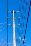 Pole. A hydro pole against a blue sky Stock Photos