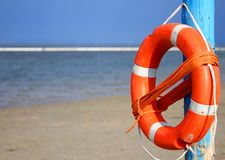 Pole with lifejacket at sea on the beach 2 Stock Photography