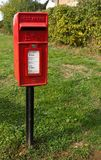 A pole mounted mail box in Sawbridgeworth, Hertfordshire stock photo