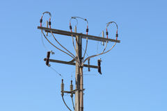 Pole of power line against the blue sky. Image of pole of power line against the blue sky Stock Photos