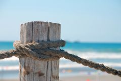 Pole with rope at beach Stock Image