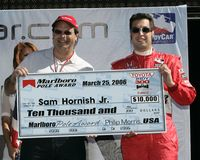 2006 Toyota Indy 300. Pole sitter Sam Hornish Jr receives a check for winning the pole during driver introductions prior to the start of the Toyota Indy 300 at stock photos