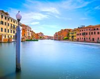 Pole and soft water on Venice lagoon in Grand Canal. Long exposu Royalty Free Stock Photos