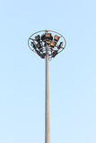 Pole spotlights with blue sky. Royalty Free Stock Photo