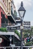Pole with street signs in French Quarter, New Orleans, Louisiana royalty free stock photography