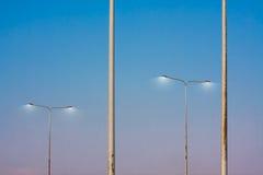 Pole streetlight in evening Stock Photos