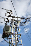 Pole with transformer. View of the distribution of electric energ Stock Photography
