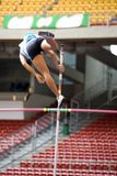Pole Vault. Image of a female pole vaulter in action Royalty Free Stock Photo
