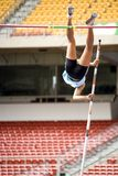 Pole Vault. Image of a female pole vaulter in action Stock Photo