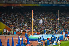 Pole vault athlete and camera flash. Camera flash goes off in the crowd as Brazil�s Fabiana Murer clears the bar in women's pole vault at the Birds Nest Royalty Free Stock Photo