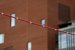 Pole Vault Crossbar on background of the building.  stock image