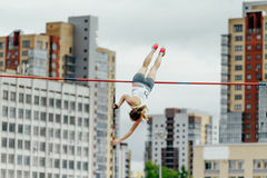Pole vault female athlete royalty free stock photos